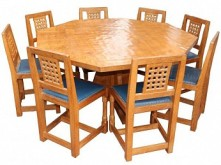 PETER RABBITMAN HEAP OF WETWANG OCTAGONAL DINING SUITE WITH 8 LATTICE BACK CHAIRS