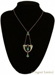 AN ART NOUVEAU SILVER AND ENAMEL DROP PENDANT BY CHARLES HORNER 1