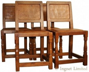 ROBERT MOUSEMAN THOMPSON SET OF FOUR CLASSIC ADZED OAK PANELLED BACK DINING CHAIRS 1